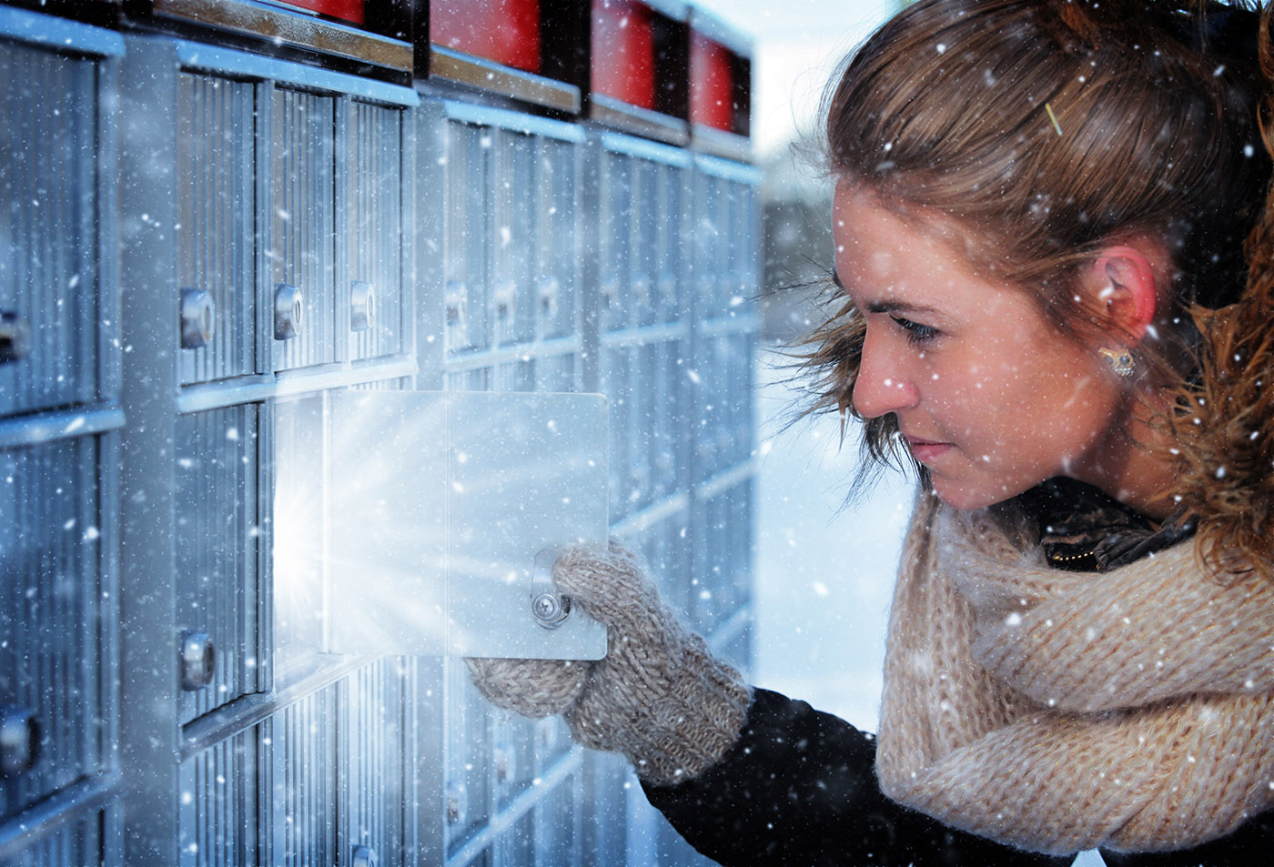 Pretty Woman Looking at Highlighted Mailbox in Winter - Royalty-Free Stock Imagery