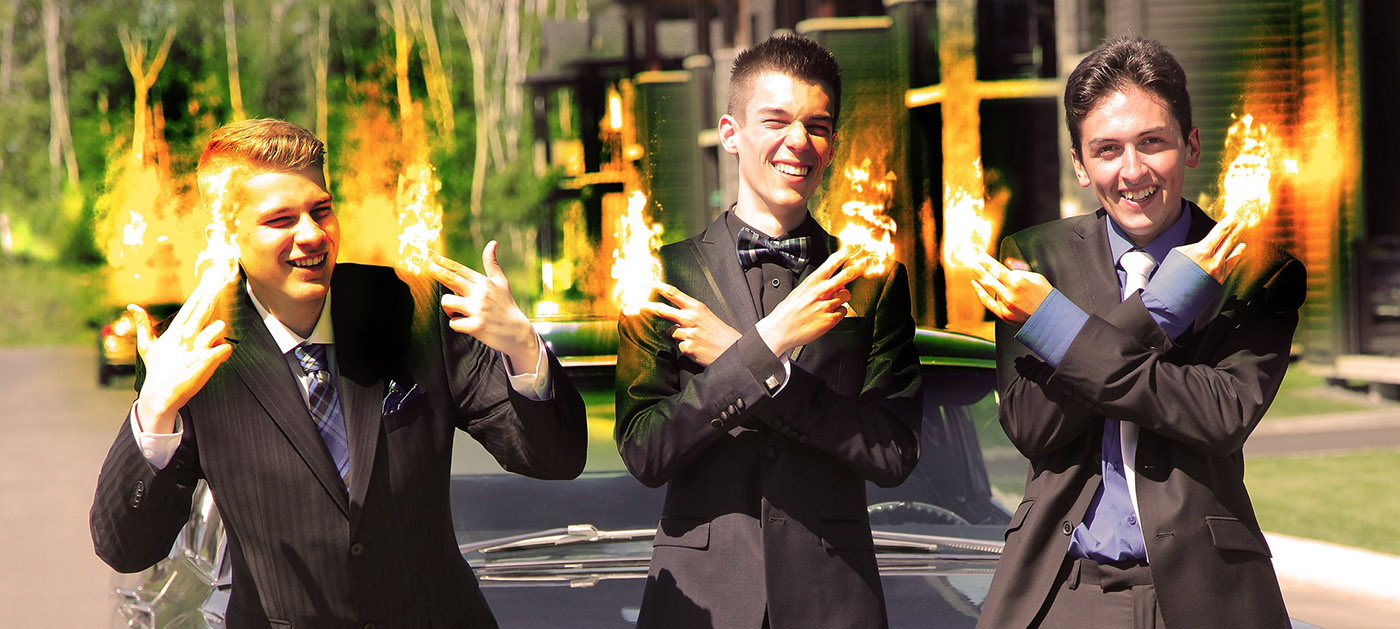 Young Men with Fingers on Fire - Royalty-Free Stock Imagery